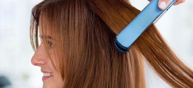 Бразильське вирівнювання волосся закріплюється праскою